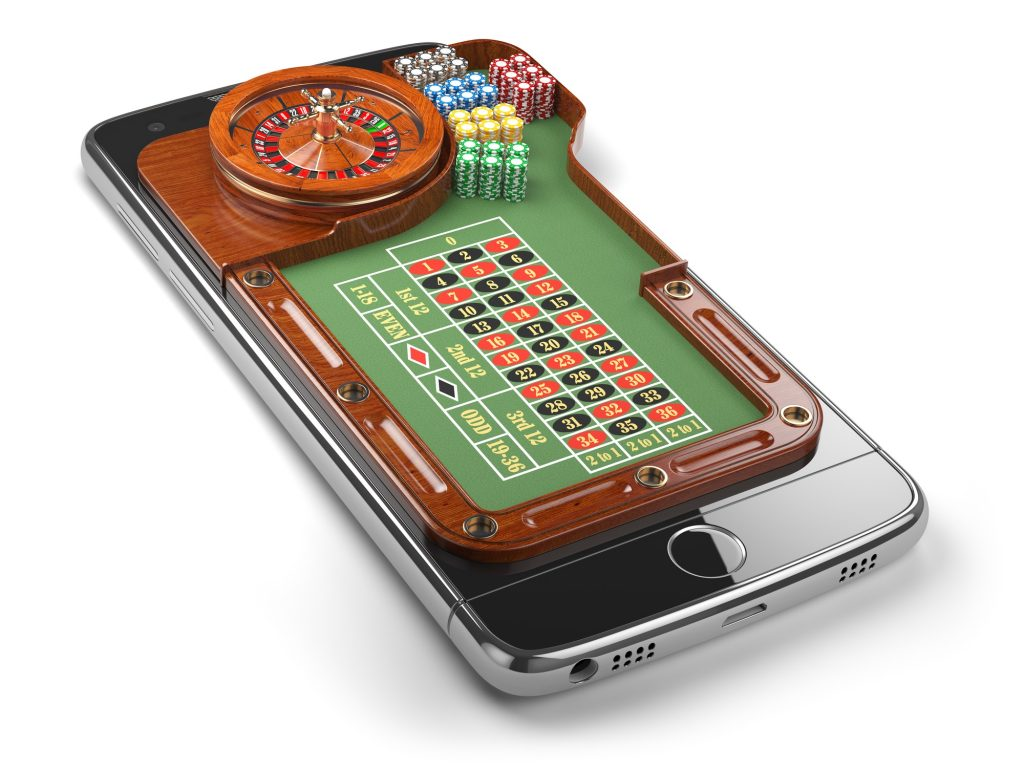 Mobile phone with roulette and casino chips isolated on white b